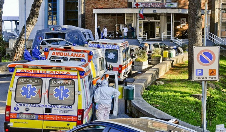 Ambulances queue up outside at the Cotugno Hospital in Naples